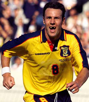 Craig Burley of Scotland reacts after scoring his team's first goal against Norway during their World Cup Group A soccer match at Parc Lescure stadium in Bordeaux Tuesday, June 16, 1998. Others teams in Group A are Brazil and Morocco. (AP Photo/Ricardo Mazalan)